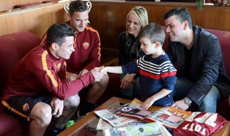 Totti e Iturbe con il piccolo Alessio