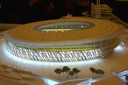 """A picture shows a model of the Rome's new stadium project designed by US architect Dan Meis during a press conference on March 26, 2014 in Rome. AS Roma officially announced plans for a new, purpose-built 52,000-seater stadium that would end the Serie A club's shared tenancy of the Olympic Stadium with city rivals Lazio. Under American chairman James Pallotta, Roma, currently second in the league 11 points behind champions Juventus, are bidding to become """"one of the world's most successful football clubs"""", according to the club. Pallotta sees the move to the 'Stadio della Roma' to the south-west of the city as a major step in the Giallorossi's long-term strategy of challenging for titles at home and abroad. AFP PHOTO / GABRIEL BOUYS        (Photo credit should read GABRIEL BOUYS/AFP/Getty Images)"""